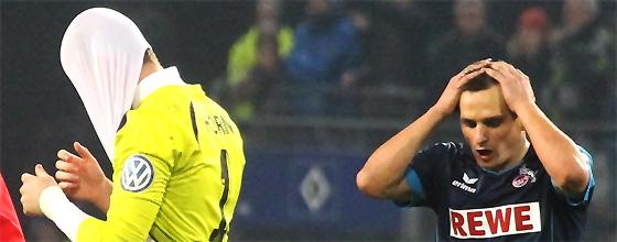 Timo Horn und Slawomir Peszko sind enttäuscht nach der Niederlage des 1.FC Köln gegen den Hamburger SV in DFB Pokal Achtelfinale der Saison 2013 / 2014